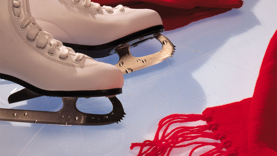 Ice skates and red scarf