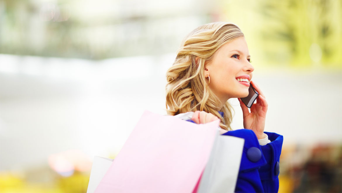 Woman talking on phone shopping