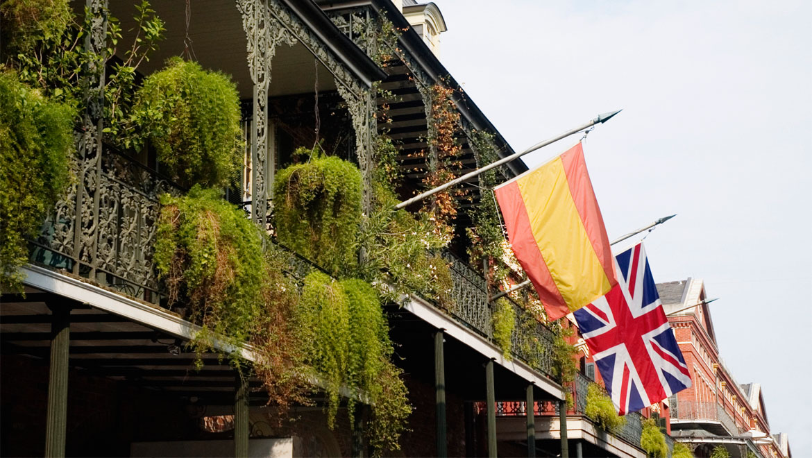 New Orleans balconies with Spanish and British flags