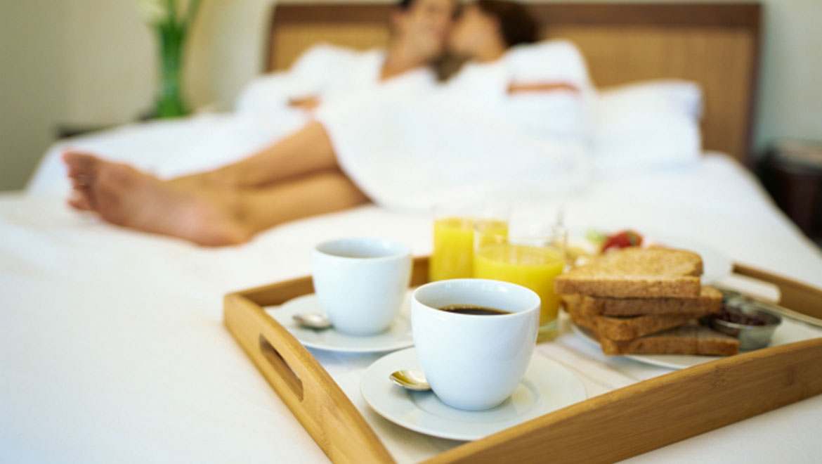 Couple and breakfast in bed