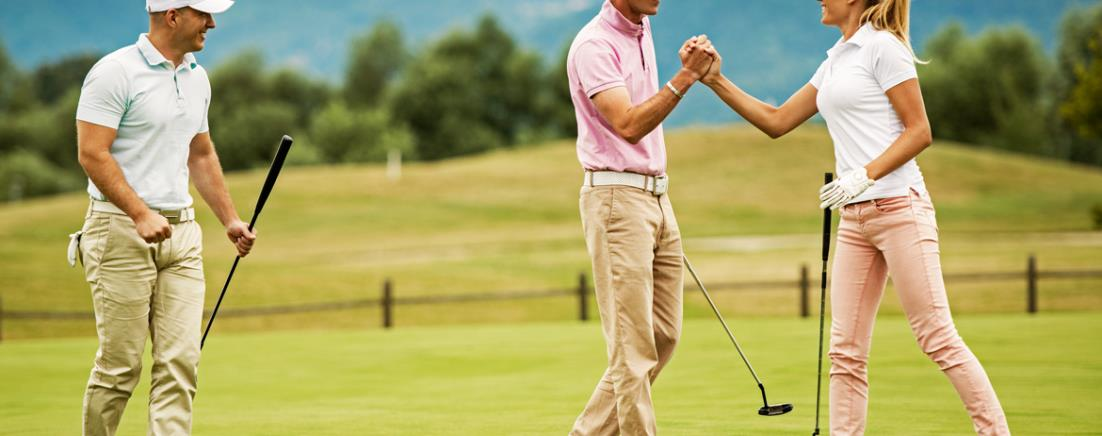 Couple high five on golf course