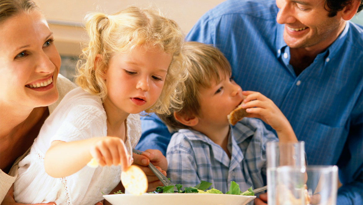 Kids eating with parents