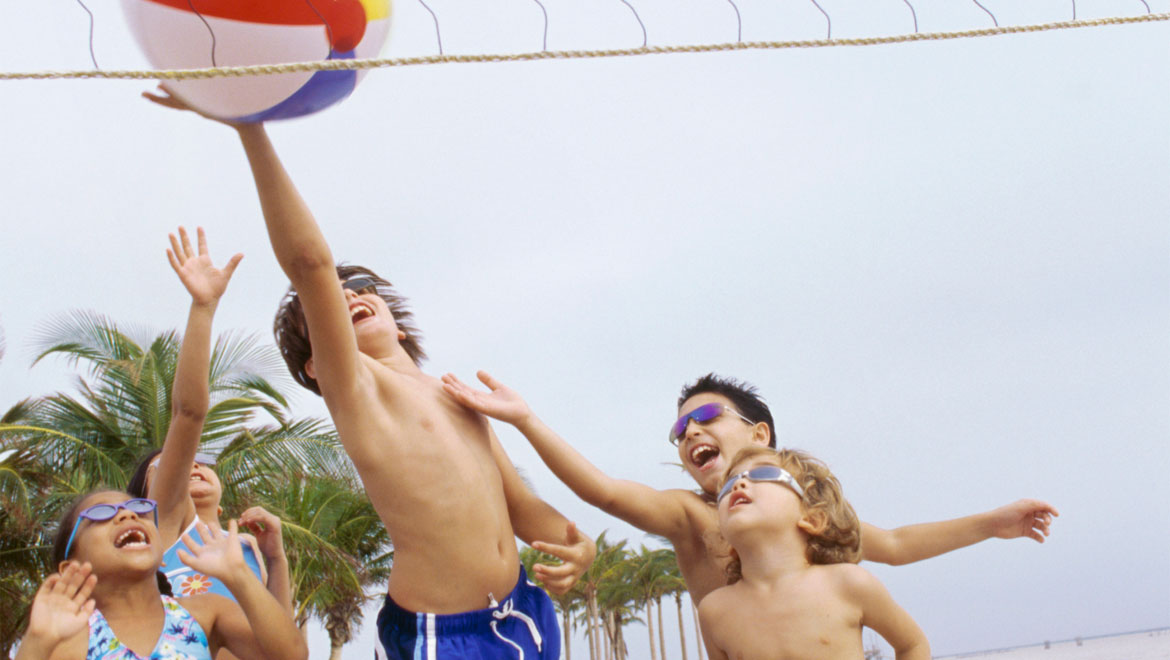 Kids playing beach volleyball