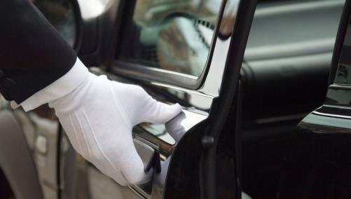 White glove opening car door