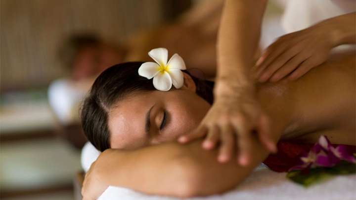 Woman with flower being massaged