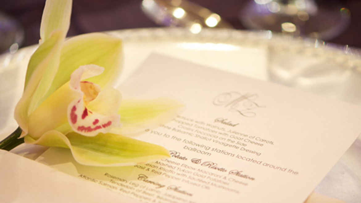 Orchid on plate with menu