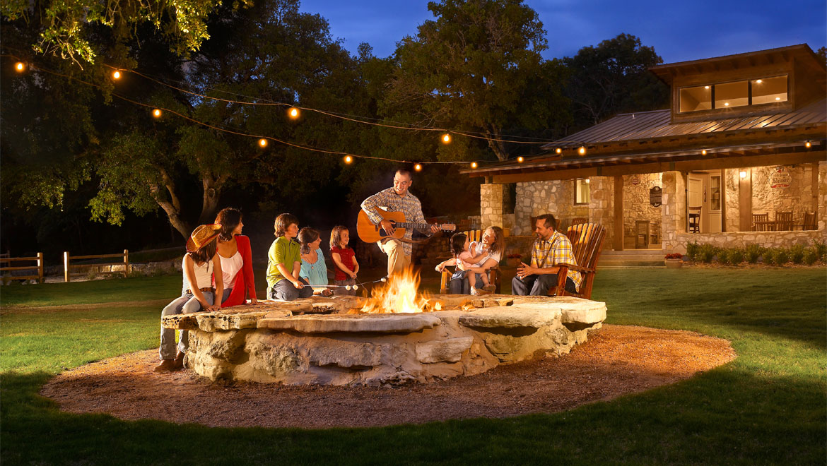 Group singalong around firepit at Barton Creek