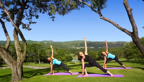 Ladies practicing yoga at Barton Creek