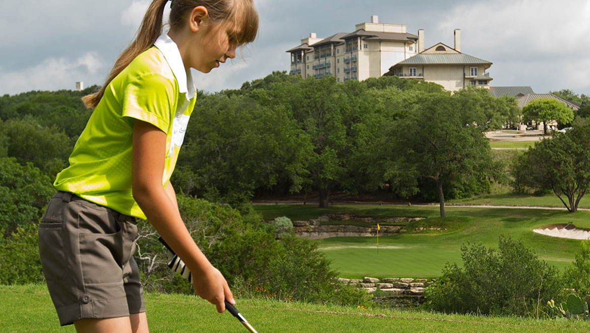 Girl golfing at Barton Creek