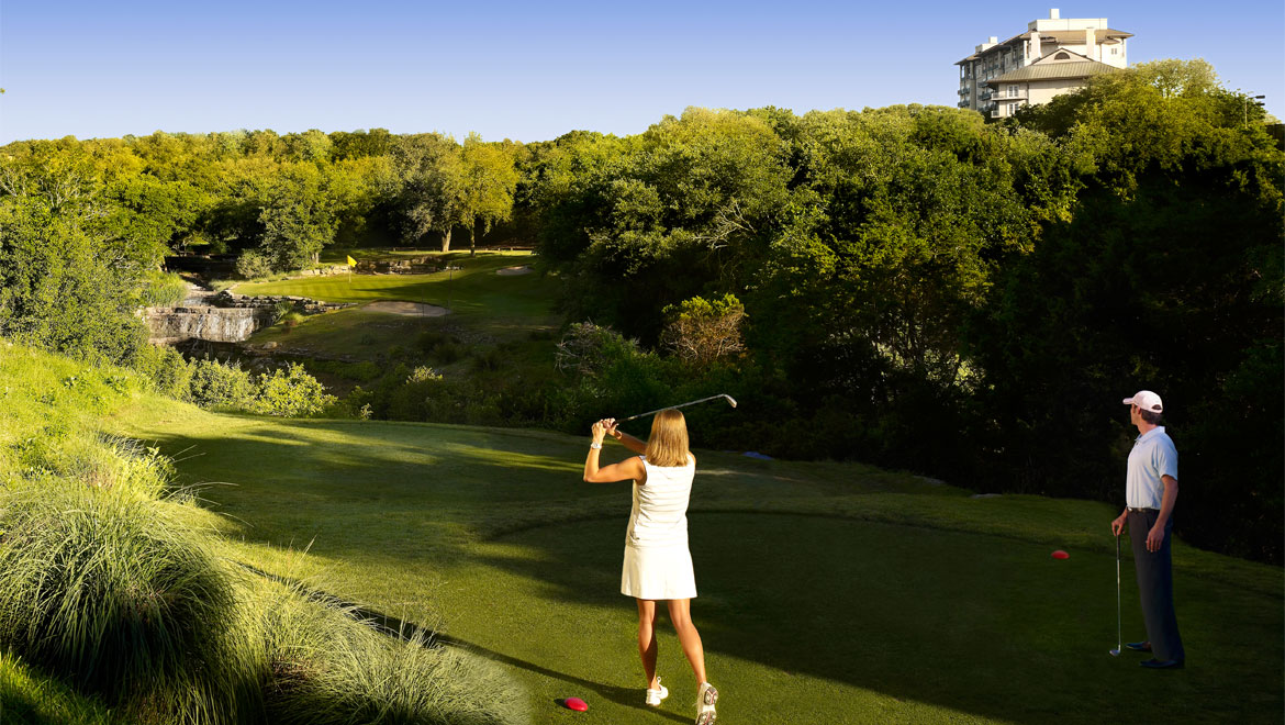 Woman golfing at Barton Creek