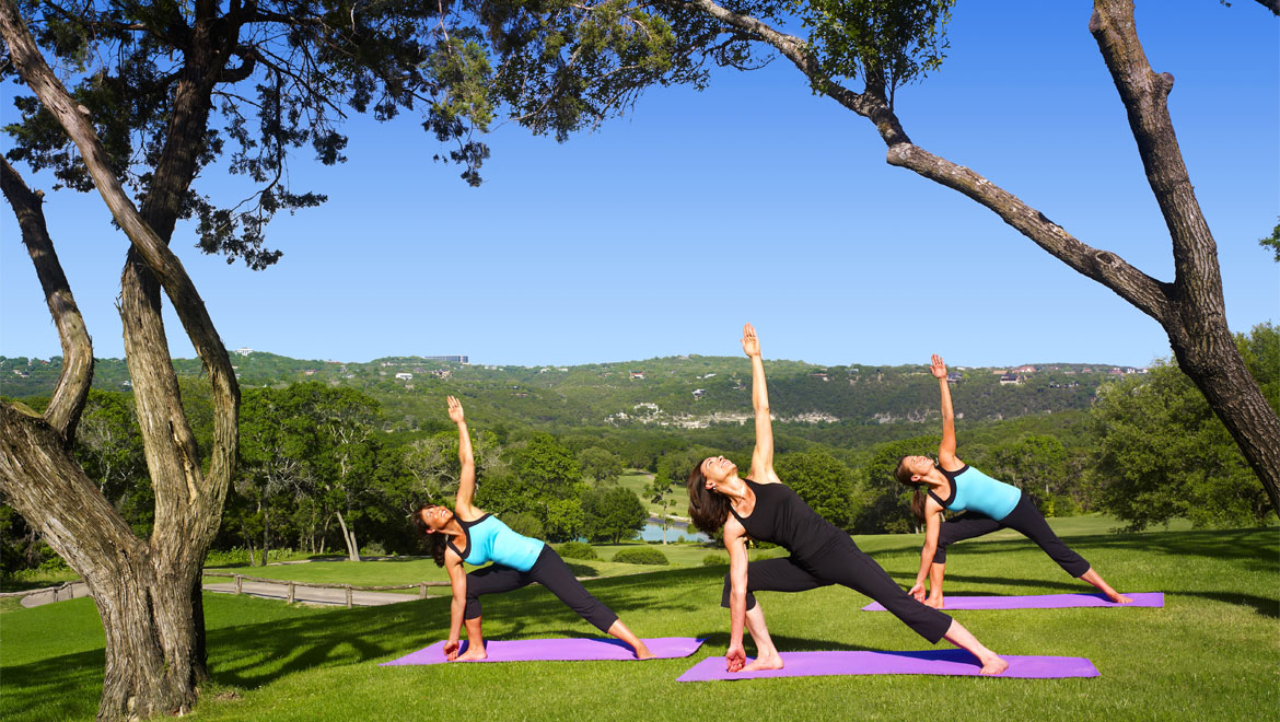 Women practicing yoga at Barton Creek