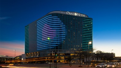 Omni Dallas Hotel exterior at dusk