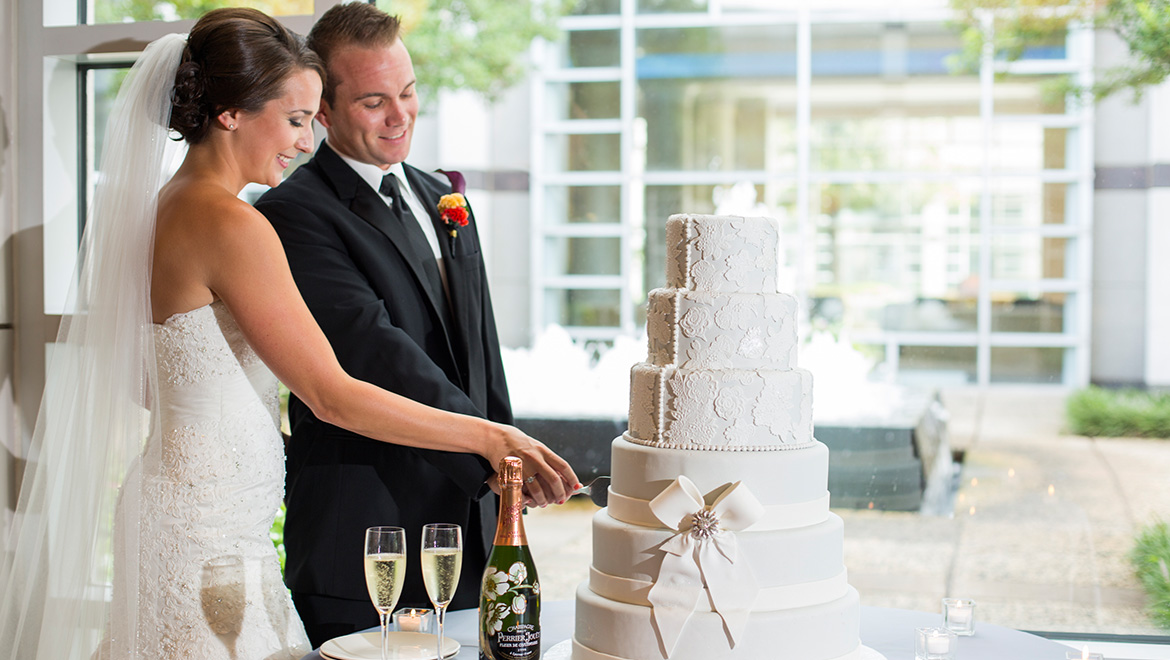 Newlyweds cutting cake