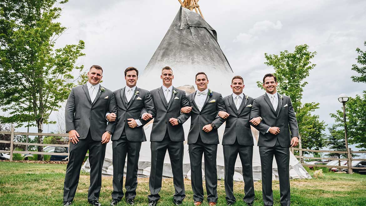 Groomsmen next to Interlocken tee-pee