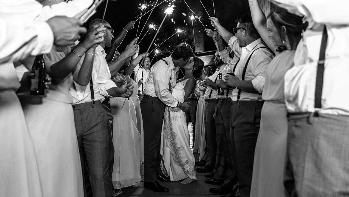 Bride and groom grand exit with sparklers