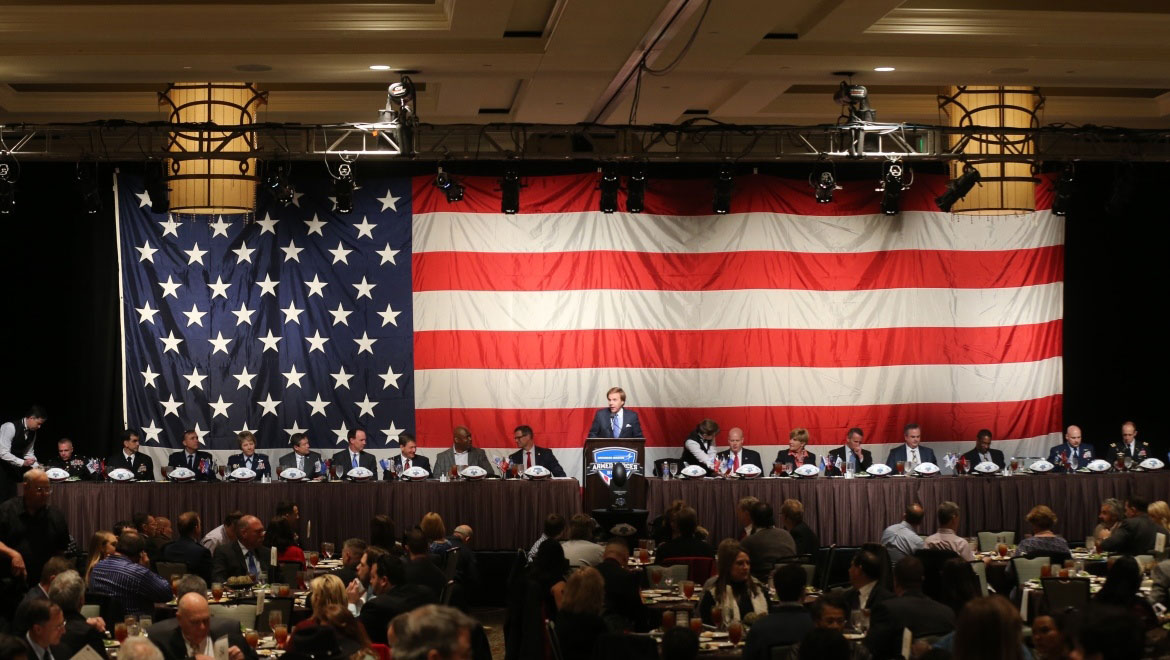 Attendees on stage at Armed Forces Luncheon