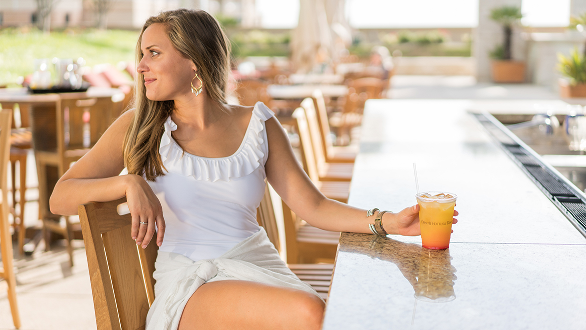 Woman waiting for friend at pool bar