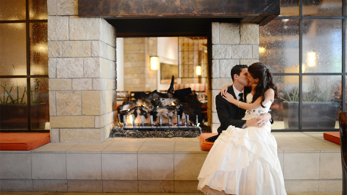 Wedding couple in front of fireplace