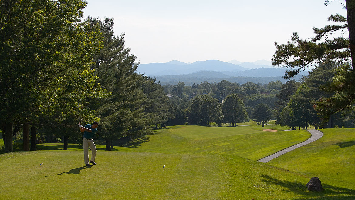 teeing off on a Blue Ridge Mountain course