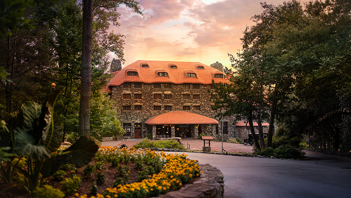 sunset arrival view of the historic Main Inn at The Omni Grove Park Inn
