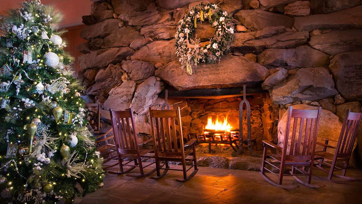 great hall fireplace with christmas tree