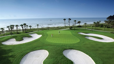 Ocean side 10th green on the Robert Trent Jones Golf Course at nearby Palmetto Dunes