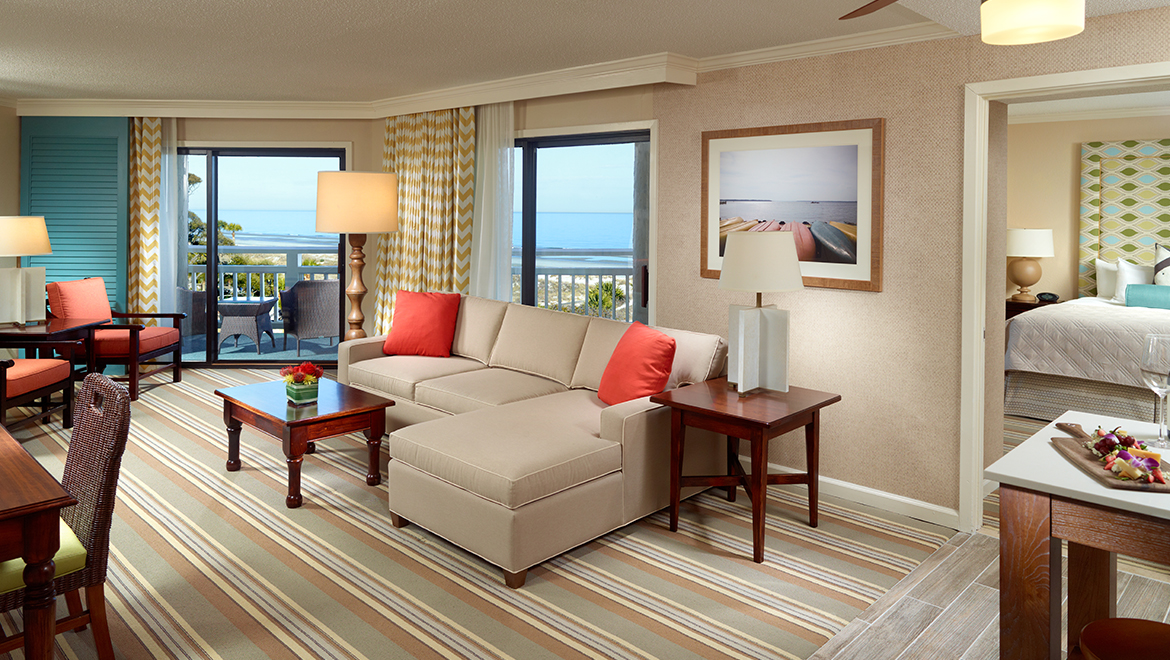 Newly renovated oceanfront luxury suite with king bed and parlor with sofa