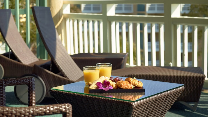 Oceanfront Luxury Suite balcony with pastries and juice