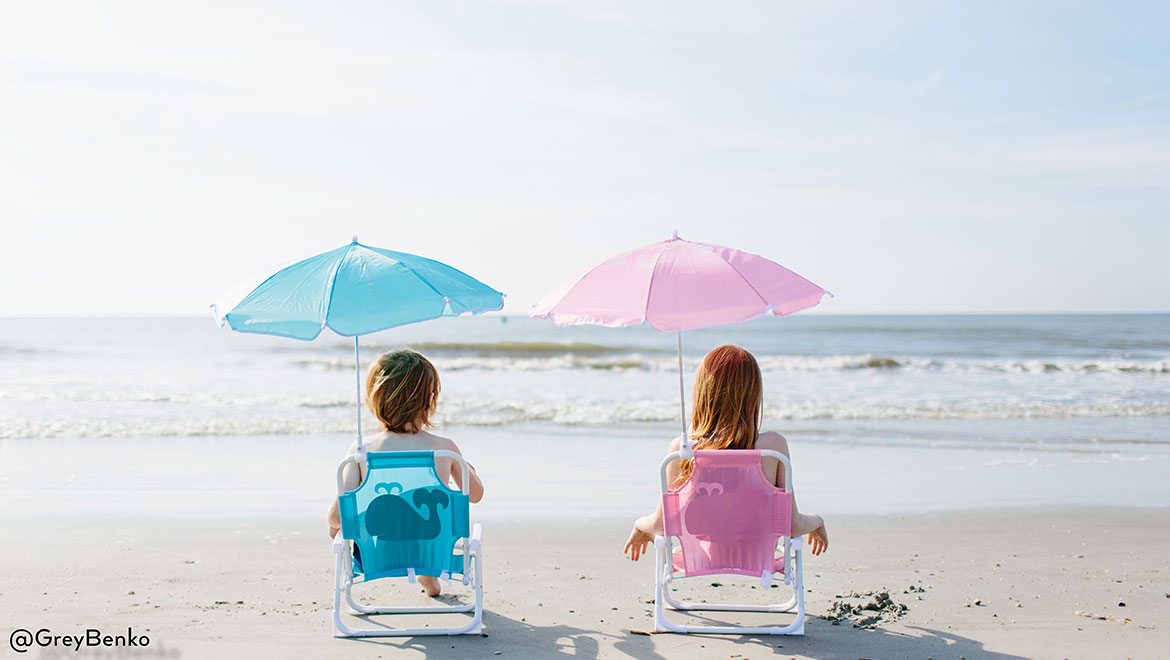 Kids on the beach in chairs