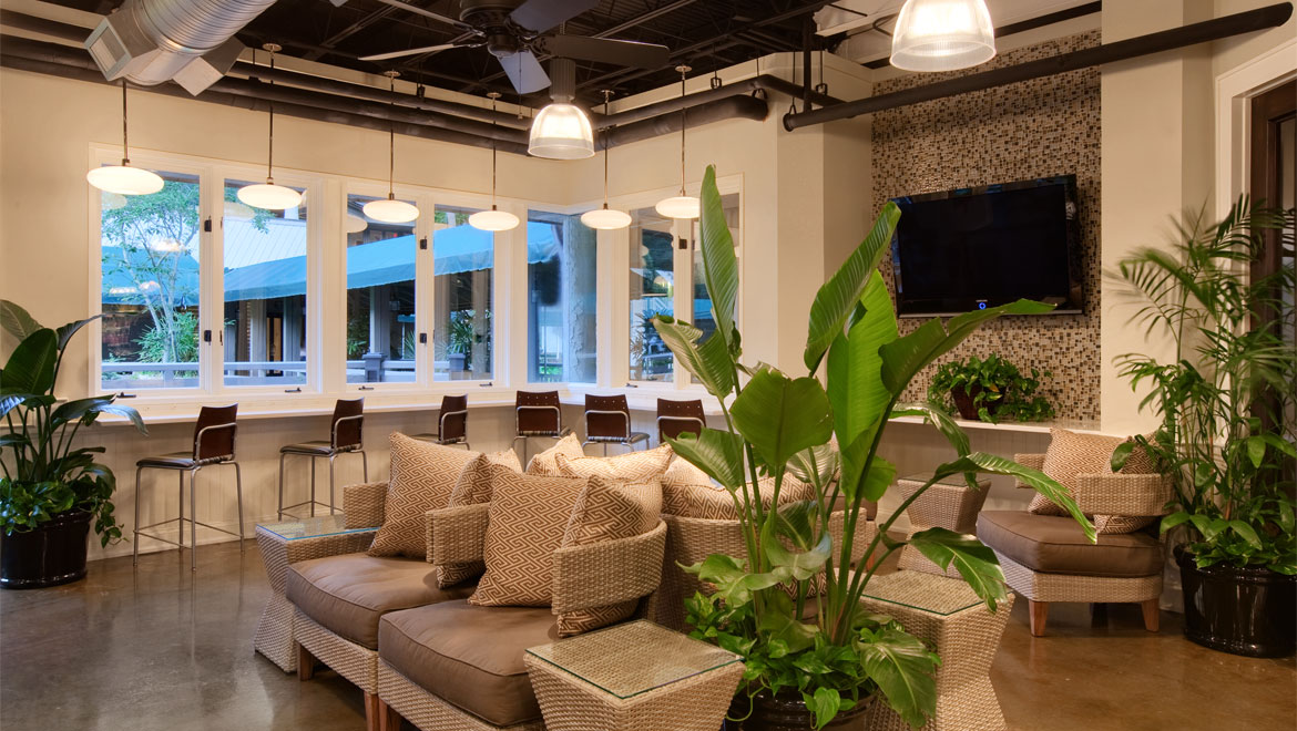 Palmetto Market seating area with flat screen TV