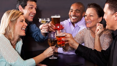 group of friends toasting and laughing