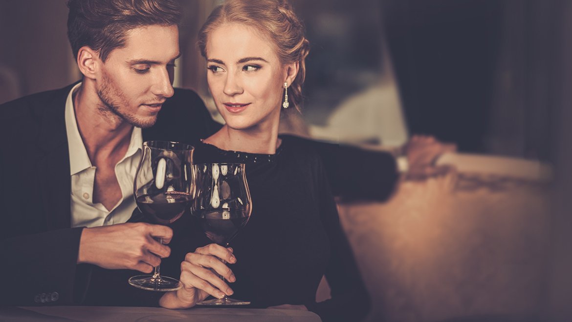 Couple having wine dinner