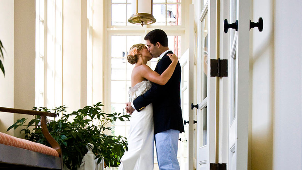 Bride and groom kissing at the Homestead