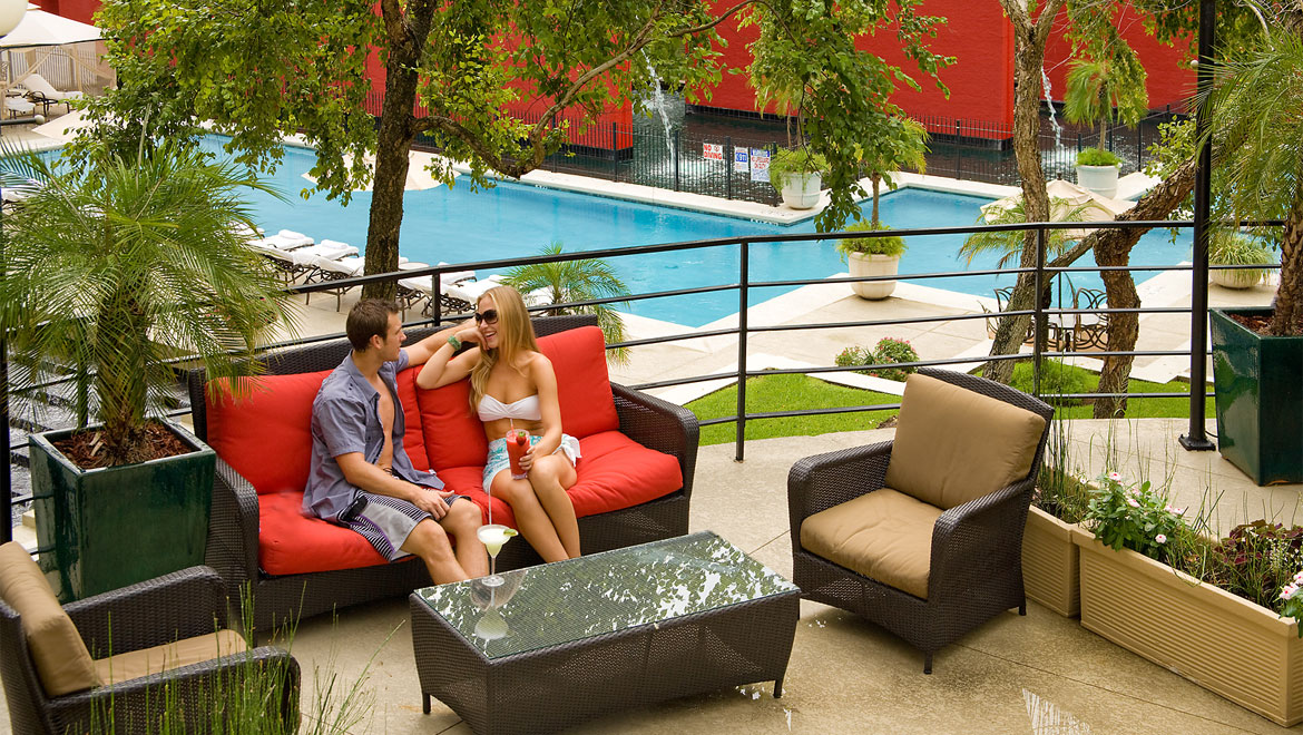 Couple relaxing on patio at Houston hotel