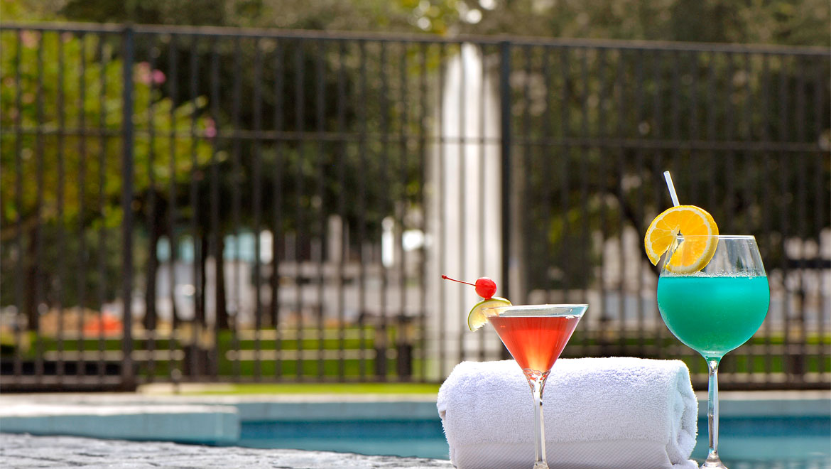 Drinks and towel by the pool at Houston Westside hotel