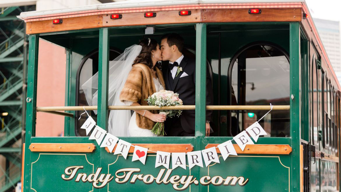 Bride and Groom Kissing in Trolley