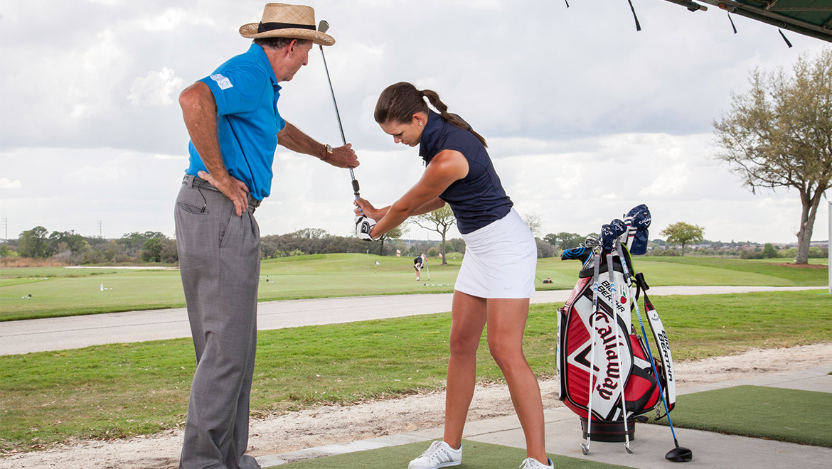 Woman learning to golf at Leadbetter Golf Academy