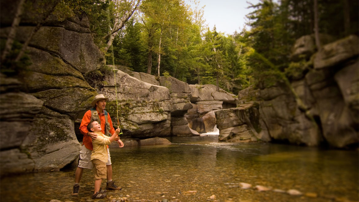Father and son fly fishing at Mount Washington