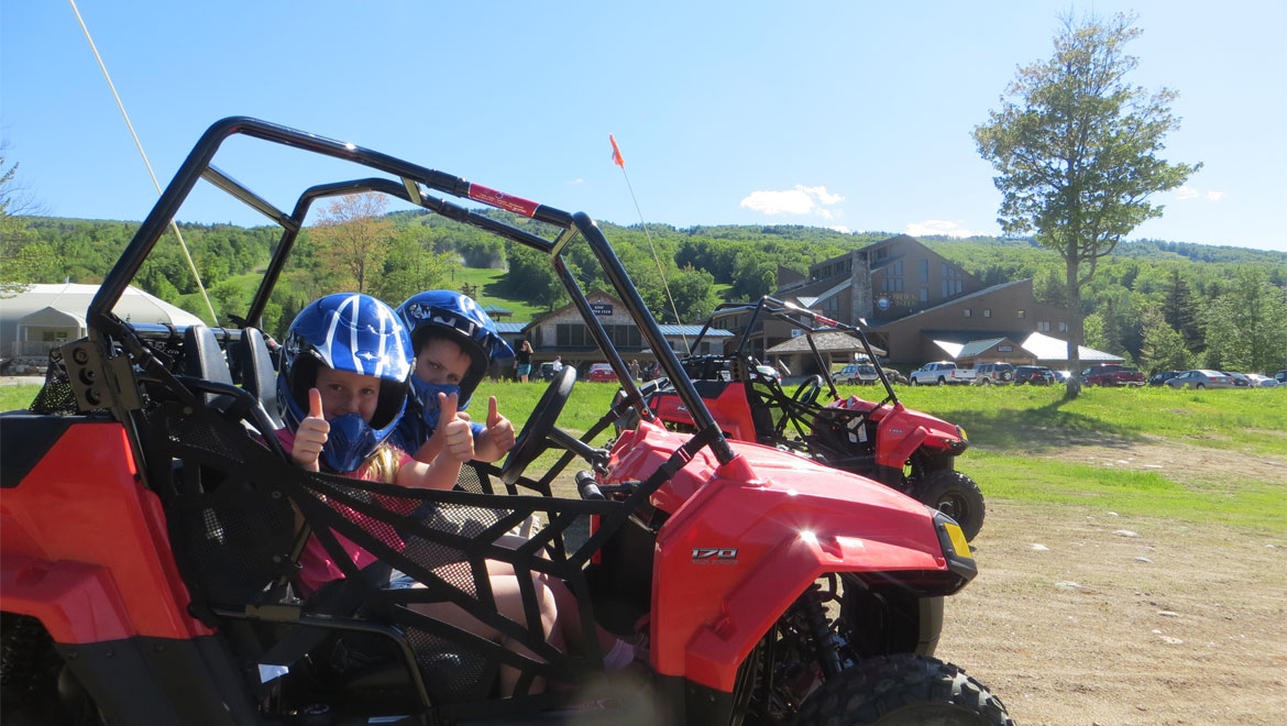 Kids in four wheeler at Mount Washington
