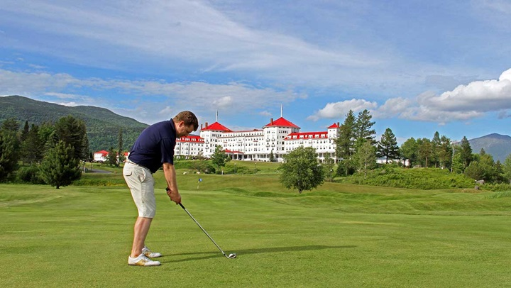 Man Golfing on Mount Washington Course