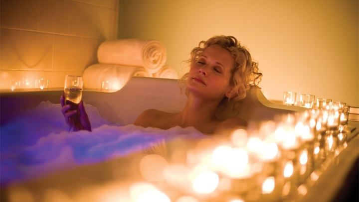 Woman relaxing in spa tub at Mount Washington