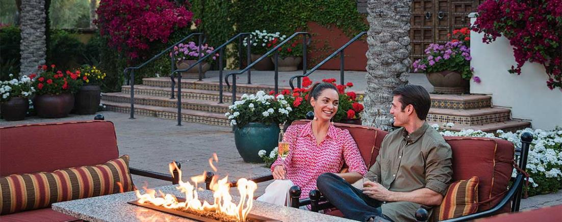 Couple sitting by firepit