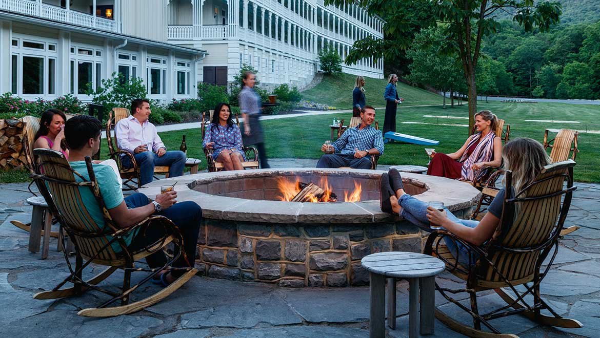 People around resort fire pit