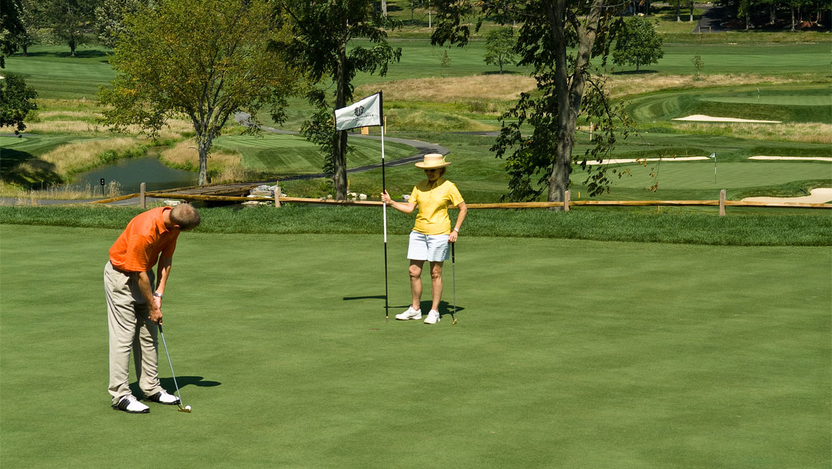 Couple golfing at Bedford Springs golf course