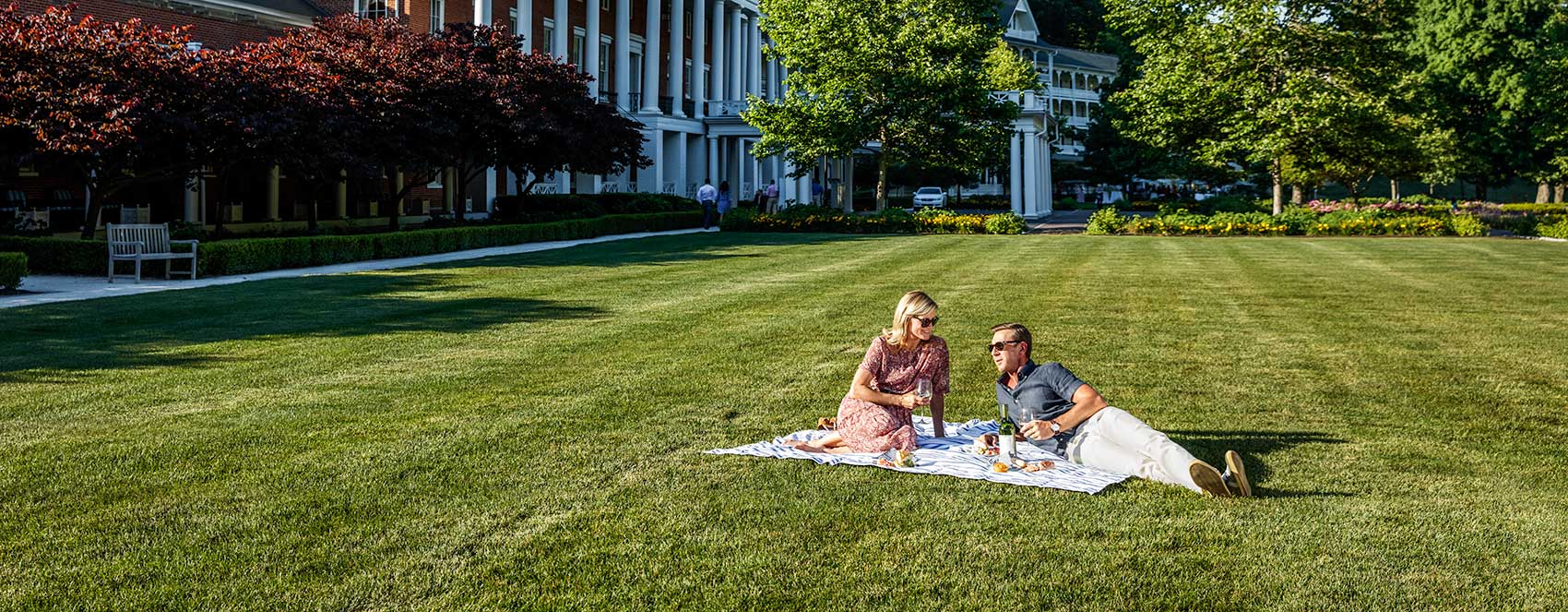 Couple picnicking on Bedford lawn