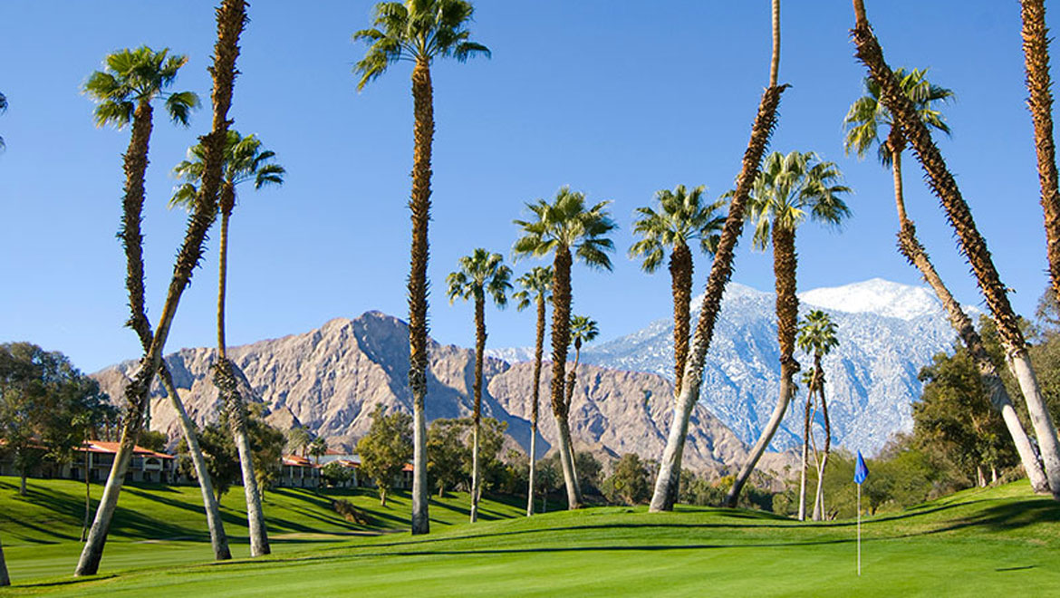 Omni Rancho golf course with mountains and palm trees