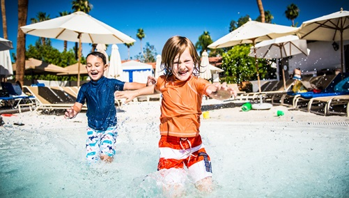Kids splashing in the pool at Omni Rancho
