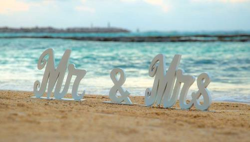 Mr. and Mrs. logo on beach