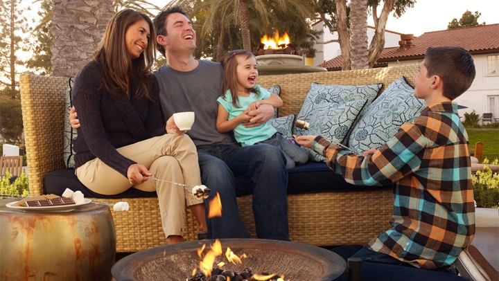 La Costa family outside by fire pit