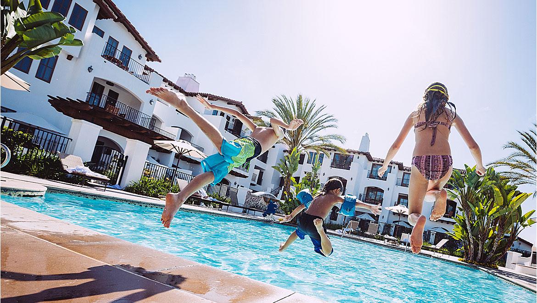 Kids Jumping in Pool Carlsbad Resort near